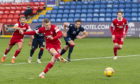 Lewis Ferguson scores a penalty to make it 2-0 to Aberdeen in their impressive win against Ross County