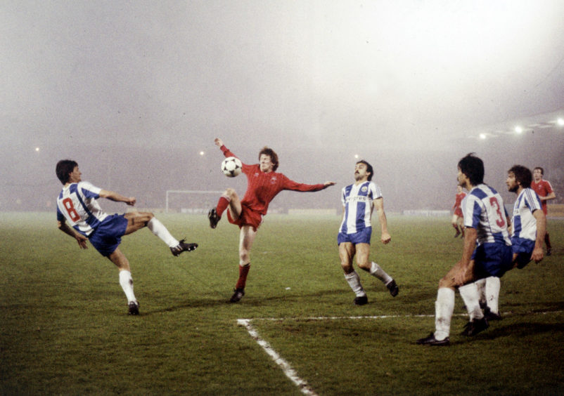 Gordon Strachan of the Dons in a tussle for the ball.
