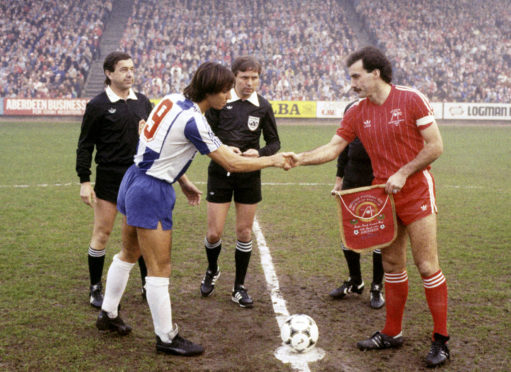 Aberdeen captain Willie Miller shakes hands with the Porto captain Fernando Gomes ahead of the second leg of the European Cup Winners' Cup semi-final at Pittodrie in 1984.
