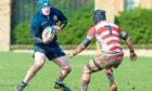 Matthew Emmison in action for Scotland Under-19s.