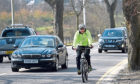 PC Scott Leslie being overtaken by a car during Operation Close Pass at Duthie Park