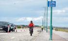 A cyclist at Aberdeen beach