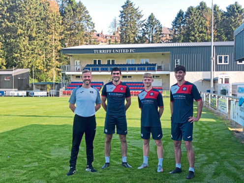 Turriff United manager Kris Hunter with new signings Luke Turner, Tyler Mykyta and Connor Power.