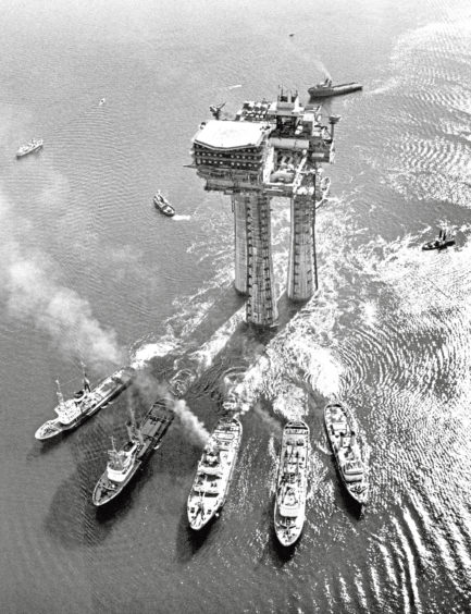 1975: An oil platform is transported from Stavanger, Norway to the Brent oil and gas field in the North Sea.