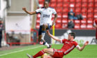 Rangers' Joe Aribo (left) and Aberdeen's Scott McKenna battle for the ball during the Ladbrokes Scottish Premiership match at Pittodrie Stadium.