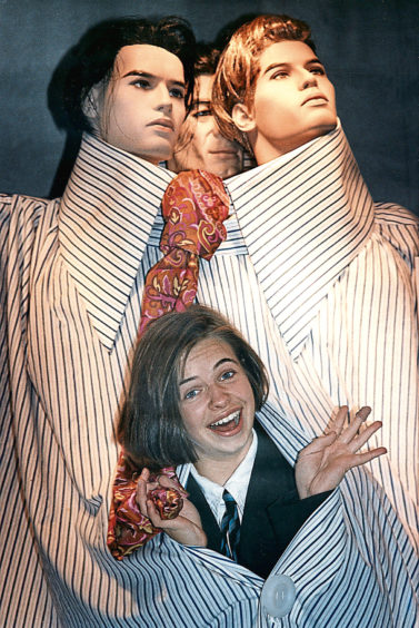 1992:  Suzanne Mireylees tries on the world's biggest shirt in an E&M's promotion.