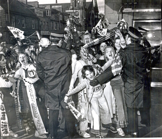 1975: Young Bay City Rollers fans queue for tickets outside the Capitol Cinema, Union Street
