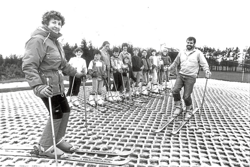 1987: Lumsden Primary School pupils pictured during their weekly skiing class at the dry ski slope in Alford. On the left is Ski instructor Nora Anderson and on the right is Mr Alistair Mackay, head teacher at Lumsden Primary School.