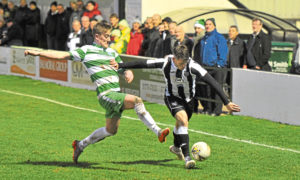 Ryan Cowie gets past  Buckie's Kyle Macleod. Picture by Paul Glendell