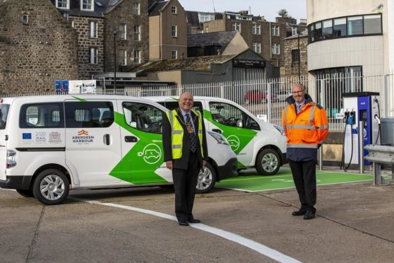 Lord Provost Barney Crockett with Malcolm Brown of Aberdeen Harbour with one of the new electric vehicles