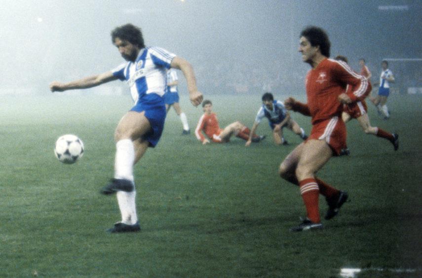 Porto's Eurico shields the ball as Mark McGhee closes in.