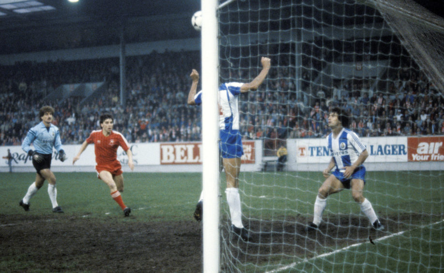 Porto's Pereira clears off the line as John Hewitt races in.
