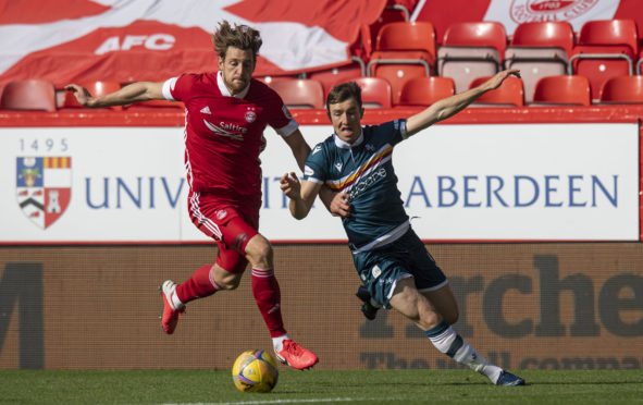 ABERDEEN, SCOTLAND - SEPTEMBER 20: Aberdeen's Ash Taylor and Motherwell's Christopher Long in action during a Scottish Premiership match between Aberdeen and Motherwell at Pittodrie on September 20, 2020, in Aberdeen, Scotland (Photo by Ross Parker / SNS Group)