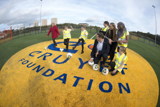 10/10/19 Co leaders, Councillor Jenny laing and Councillor Douglas Lumsden ttryout the pitch with help from Tullos primary school Pr 6- Tullos pupils get first experience of new Cruyff Court Neale CooperTullos Primary School pupils made their first trip to Cruyff Court Neale Cooper today (10 October) as final preparations are made for the opening of the new £300,000 community facility.Construction is on course to completed early and local children were given a site visit to sample the court following a classroom session with the Denis Law Legacy Trust's Streetsport team and the project architect. The facility will be available for public use from early November and an official opening celebration will take place later that month.Cruyff Court Neale Cooper is being built on local authority land adjacent to the school and has been named in honour of the legendary Aberdeen player, who passed away in 2018. Aberdeen City Council, the Denis Law Legacy Trust and the Johan Cruyff Foundation are working in partnership to lead the project. The Council has allocated £250,000 of funding for the project and the Cruyff Foundation has pledged £50,000.Cruyff Court Denis Law, delivered by the same partners, became the first facility of its type in Scotland when it was opened at Catherine Street in 2017.