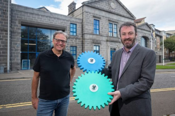Matthias Rudloff, Project Manager at Huttinger Interactive Exhibitions, with Bryan Snelling, chief executive of Aberdeen Science Centre