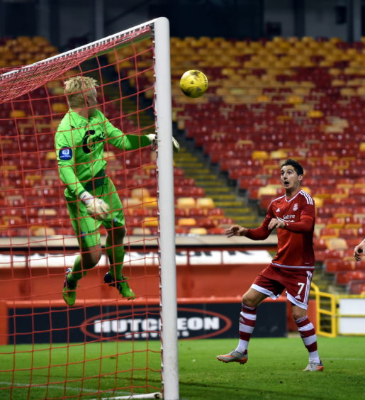 Kenny McLean heads in the Dons' late winner