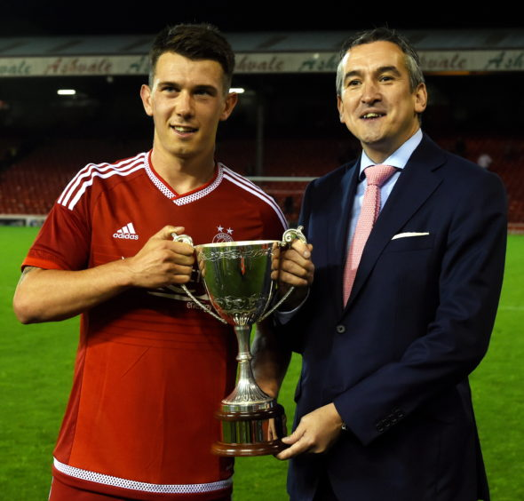 Ryan Jack with Press and Journal editor Damian Bates with the trophy