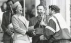 The Queen bursts out laughing on the final day of the Braemar Gathering as resin on the hand of caber champion Brian Robin makes for a sticky handshake in 1990.