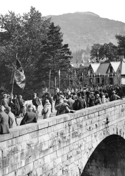 The march of the clans to the Braemar Gathering in 1928.