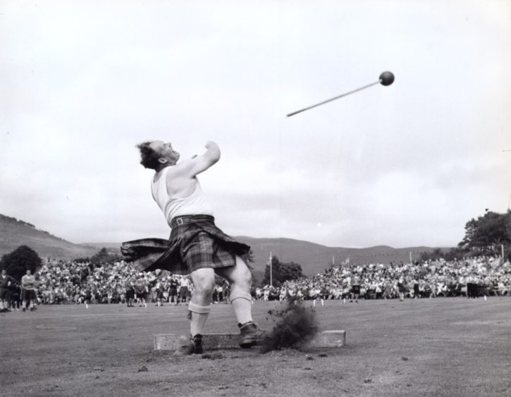 Local games heavyweight Bill Anderson puts the maximum effort into his hammer throw at the Braemar Gathering in 1969.