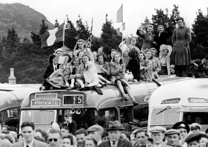Spectators get an elevated view of the Gathering on top of an Alexander's bus.