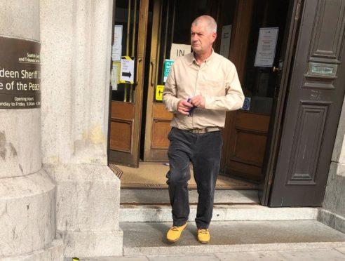 Robert Butler leaving court.