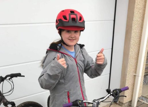 Nine-year-old Caitlin Morrice is cycling 100 miles to raise money for the Mintlaw Primary School Rocket Room