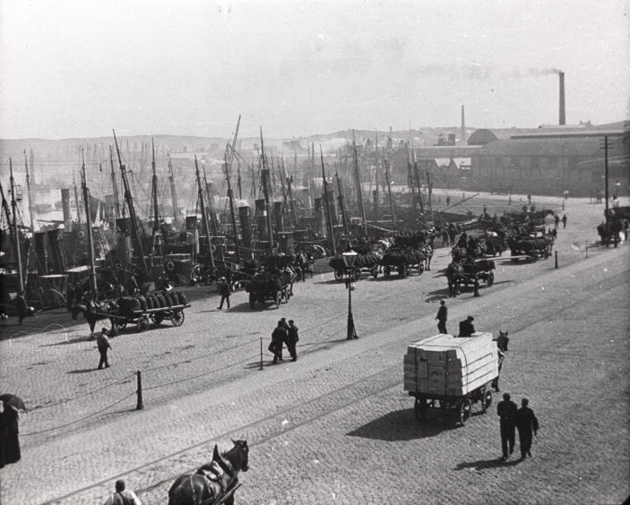 Late 19th century photograph looking east from the junction of Market Street and Palmerston Road showing Albert Quay and Albert Basin full of fishing boats. Steam trawling for white fish was introduced into Aberdeen in 1882 and, in a few years, the fleet of vessels grew to number several hundred.