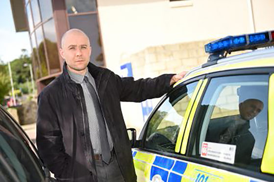 Detective Inspector Martyn Thomson