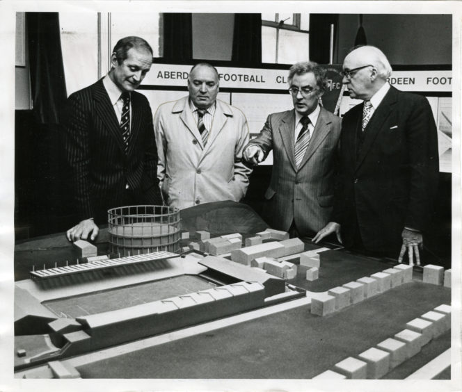 1980: Aberdeen vice chariman Chris Anderson, left builder Mr Peter Cameron, Mr A. Bremner (of A. Farquhar the builders) and Don's chairman Dick Donald examine the model of the Pittodrie club's new stand.