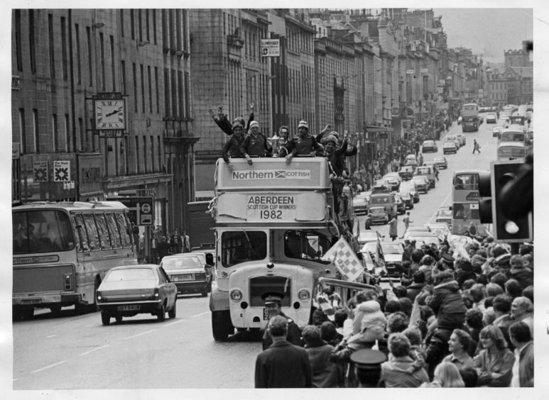1982: Aberdeen FC aboard the bus, going through the town after they won the Scottish Cup.