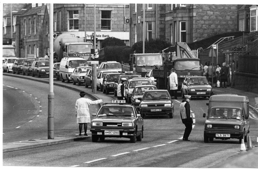 1989: Traffic queues in Aberdeen as police search for an escaped prisoner.