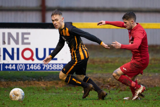 Nathan Meres, left, in Highland League action for Huntly.