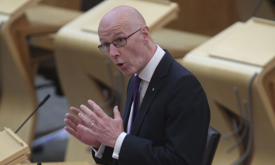 John Swinney was challenged over Aberdeen schools' safety.