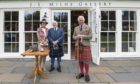 Jim Milne with his wife Gillian and HRH The Duke of Rothesay outside the Highland Games Pavillion at the Princess Royal and Duke of Fife Memorial park in Braemar.