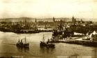1930s postcard showing the meeting point of the River Dee channel and the Tidal Harbour with Pocra Quay on the right. Steam trawler Victoria Regina (A590) heads out to sea, while Crisabelle Stephen (A374) returns to harbour.