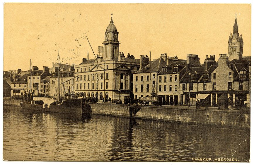 Early 20th century postcard showing the new Harbour Board Offices on Regent Quay. Designed by A. Marshall Mackenzie, the classical granite building was completed in 1885. It still occupies this prominent location overlooking the Upper and Victoria docks today. One notable feature is the building's tall, domed clock tower.