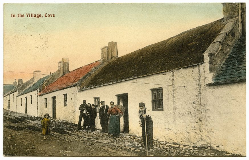 Many coastal villages of Aberdeenshire were involved in fishing. This early 20th century postcard shows a family of fisherfolk outside their house in Cove. The two younger men are holding a model sailboat and a woman has a creel on her back. The young girl on the left is barefoot.