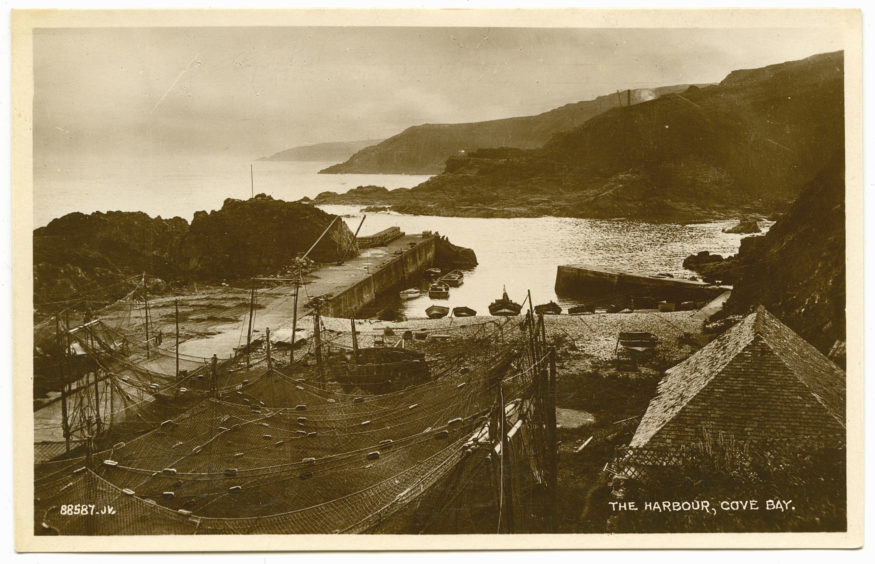Postcard showing the harbour at Cove in the early 20th century. The fishing settlement grew around a natural haven in the coastal cliffs. The harbour works shown here were completed in the late 1870s. The improvements allowed for greater fishing capacity and safety.