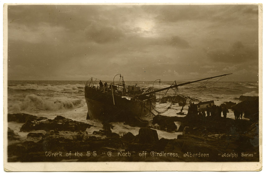 Postcard showing the wreck of the steamship G. Koch off Girdleness. The Danish cargo vessel was dashed on the rocks south of Aberdeen harbour during a bad storm on Saturday 13th January 1913. Despite heroic rescue efforts seven of the nineteen on-board died. Taking to sea was an ever-dangerous occupation.