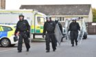 Police outside the scene of the incident in the Pinefield area of Elgin. Pictures by Jason Hedges