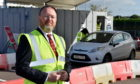 The UK Government minister for Scotland, David Duguid, visited the Covid Drive-through testing site at Aberdeen Airport Park and Depart Car Park, Wellheads Drive.