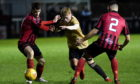 Tyler Mykyta (centre) is one of three Aberdeen youngsters to join Turriff on loan