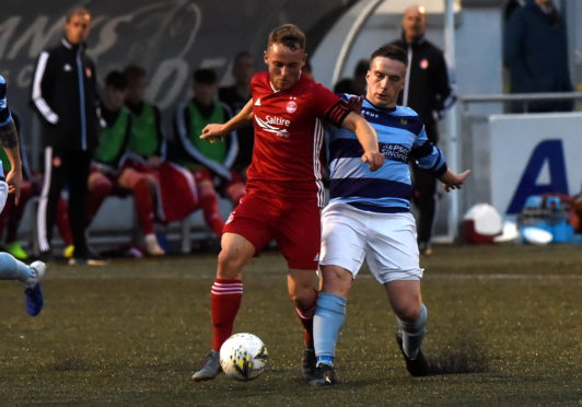 Seb Ross in action for Aberdeen against Banks o' Dee's Jack Henderson.  Picture by KENNY ELRICK     21/08/2019