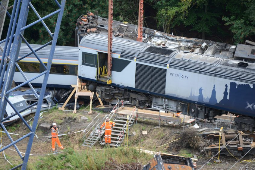 Large orange strops have been secured around the carriage crash site.  Pictures by Paul Glendell