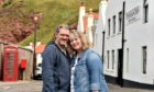 New owners of the Pennan Inn, Roland and Monika Focht