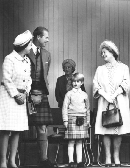 The Queen, Duke of Edinburgh, Prince Edward and the Queen Mother share a joke on their arrival at the Games in Braemar.