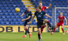 Marley Watkins heads home his first Aberdeen goal against Ross County