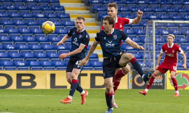 DINGWALL, SCOTLAND - SEPTEMBER 27: Aberdeen's Marley Watkins heads home to make it 1-0 during a Scottish Premiership match between Ross County and Aberdeen at The Global Energy Arena on 27 September, in Dingwall, Scotland (Photo by Bill Murray / SNS Group)