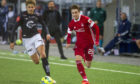 Scott Wright in action against Viking FK